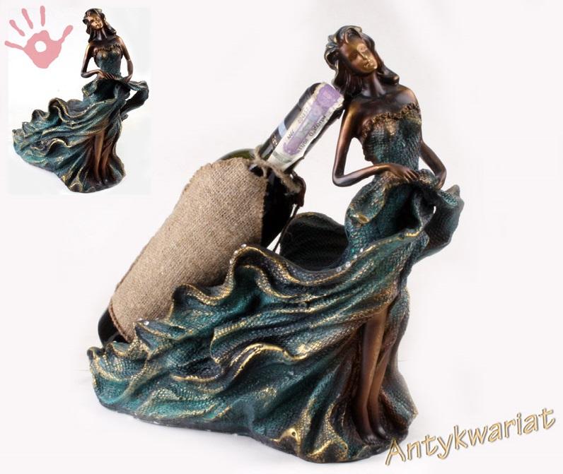 Figura kobieta-stojak na butelkę